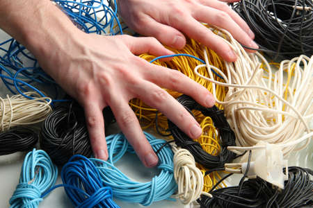 Cables and man hands, close up Stock Photo - 18598722