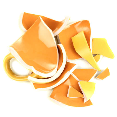 fragmented: Yellow broken cup isolated on white