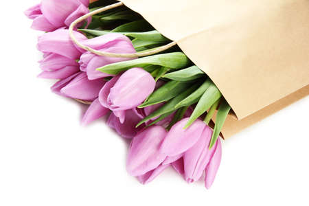 pink and brown: Beautiful bouquet of purple tulips in paper bag, isolated on white