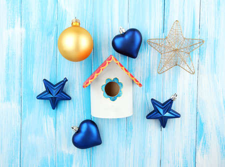 Decorative nesting box and Christmas decorations on blue background photo