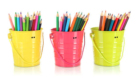 Colorful pencils in three pails isolated on white photo