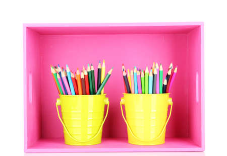 Colorful pencils in pails on shelf isolated on white Stock Photo - 18553781