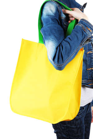 Yellow bag with green handles on shoulder isolated on whit Stock Photo - 18553896