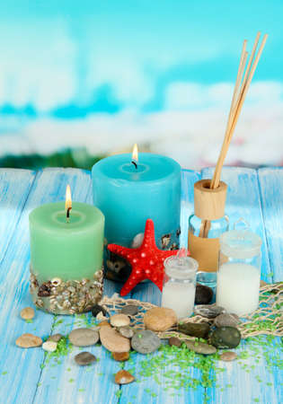Sea spa composition on wooden table on blue natural background Stock Photo - 18553902