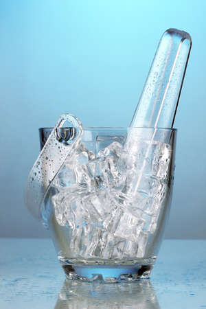 Glass ice bucket on light green background Stock Photo - 18580338