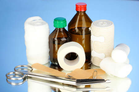 First aid kit for bandaging on blue background Stock Photo - 18579746