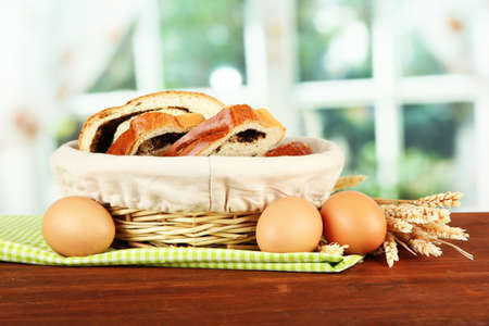 Loaf with poppy seed in wicker basket, on bright background Stock Photo - 18579997