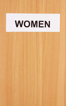 Toilet sign on wooden background Stock Photo - 18580345