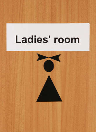 Toilet sign on wooden background Stock Photo - 18580169