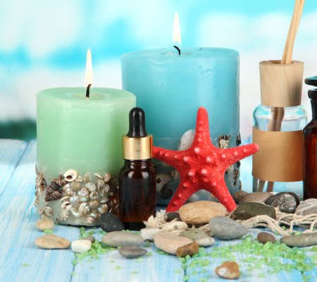 Sea spa composition on wooden table on blue natural background Stock Photo - 18578989
