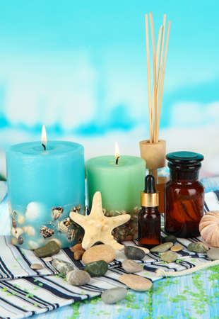 Sea spa composition on wooden table on blue natural background Stock Photo - 18579686
