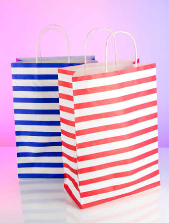 Stripped bags on light pink background Stock Photo - 18578898