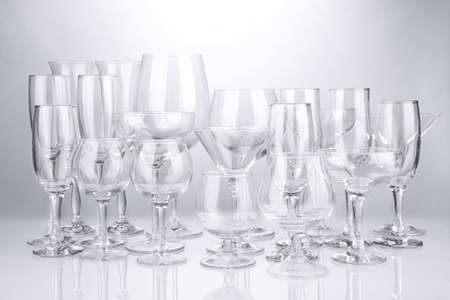 Cocktail and wine glasses, on gray background Stock Photo - 18579379