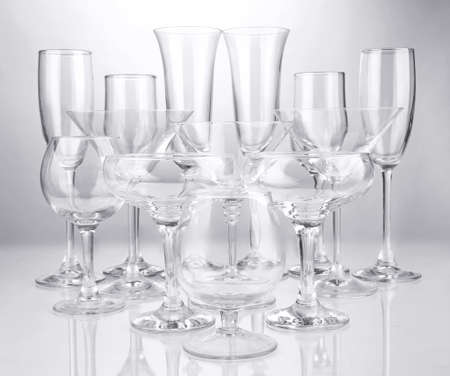 Cocktail and wine glasses, on gray background photo