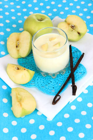 Delicious yogurt in glass with apple on blue tablecloth Stock Photo - 18580222
