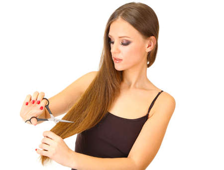 Beautiful woman with long hair and hairdresser's scissors, isolated on white Stock Photo - 19034343