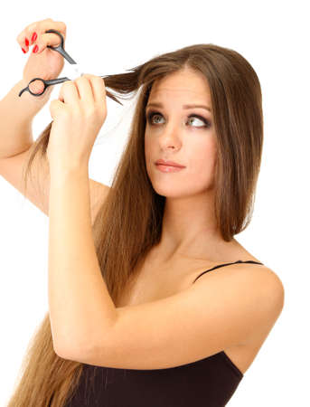 Beautiful woman with long hair and hairdressers scissors, isolated on white photo