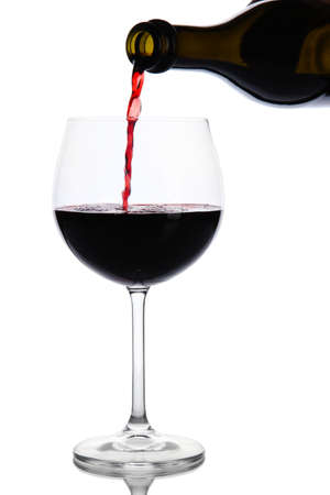 Sparkling red wine pour in glass isolated on white