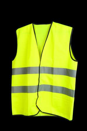 Yellow vest, isolated on black Stock Photo - 18578958
