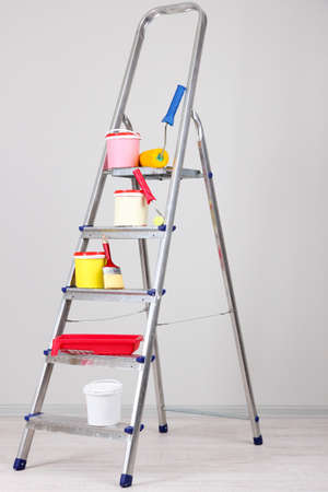 Metal ladder and paint in room Stock Photo - 18579358