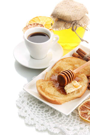 White bread toast with honey and cup of coffee, isolated on white photo