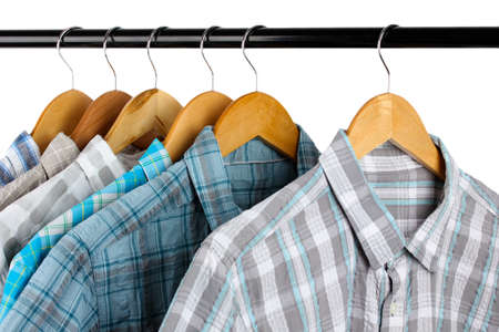 Shirts with ties on wooden hangers isolated on white Stock Photo - 18607111