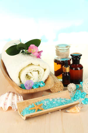 Sea spa elements on wooden table close up photo