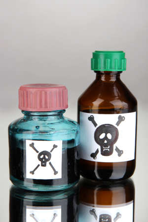 Deadly poison in bottles on grey background Stock Photo - 18605505