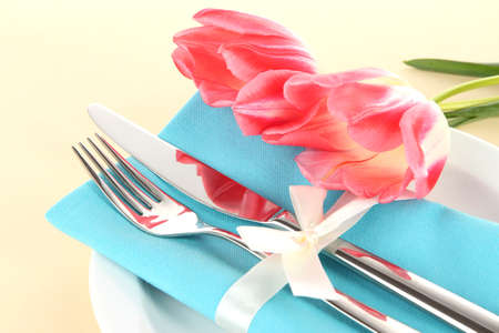 Festive dining table setting with tulips on beige background Stock Photo - 18610336