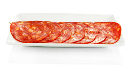 Salami slices on white plate, isolated on white photo
