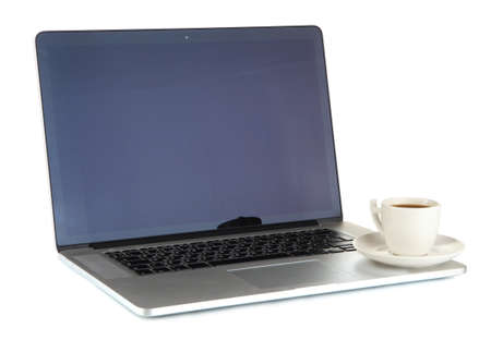 White laptop with cup of coffee isolated on white photo