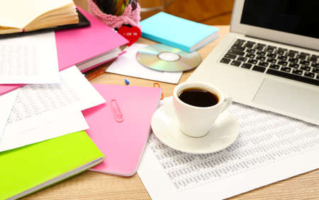documentation: Cup of coffee on office desktop close-up Stock Photo