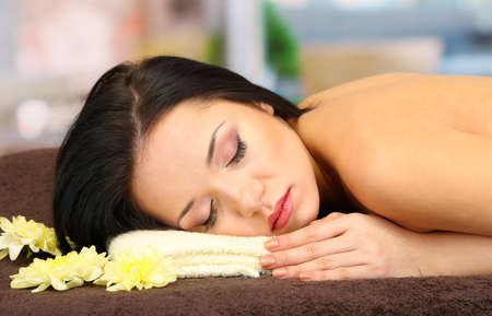 spa woman: Beautiful young woman in spa salon, on bright background Stock Photo