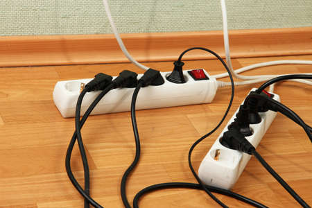 plug electric: Overloaded power boards, close up Stock Photo