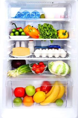 beverage fridge: Refrigerator full of food