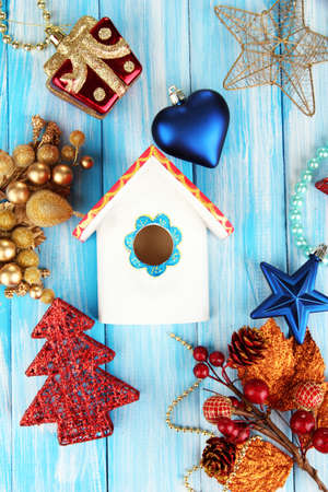 Nesting box and Christmas decorations on blue background photo