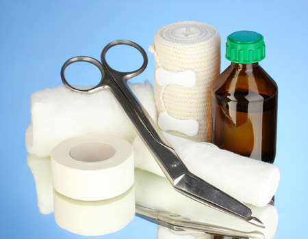 First aid kit for bandaging on blue background Stock Photo - 18668166
