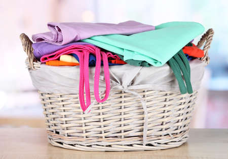Clothes in wooden basket on table in room Stock Photo - 18668563