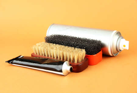 Set of stuff for cleaning and polish shoes, on color background Stock Photo - 18668212