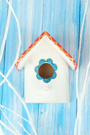 Decorative nesting box on color background photo
