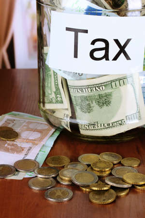 tax tips: Money in the bank on room background