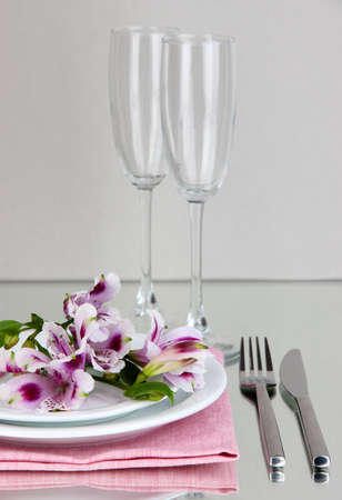 Festive table setting with flowers on grey background photo