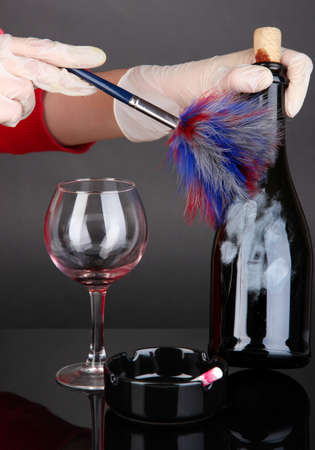 Taking fingerprints with bottle of wine isolated on black Stock Photo - 18668245