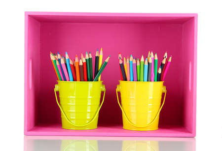 Colorful pencils in pails on shelf isolated on white photo