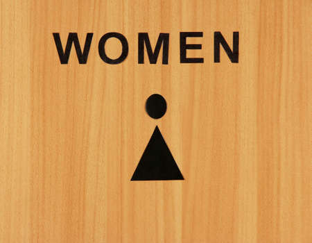 Toilet sign on wooden background photo