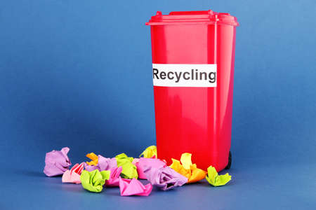 Recycling bin with papers on blue background Stock Photo - 18686157