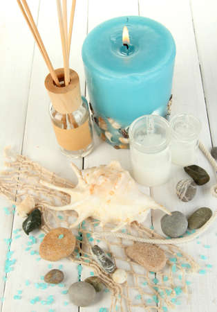 Sea spa composition on wooden table close-up photo
