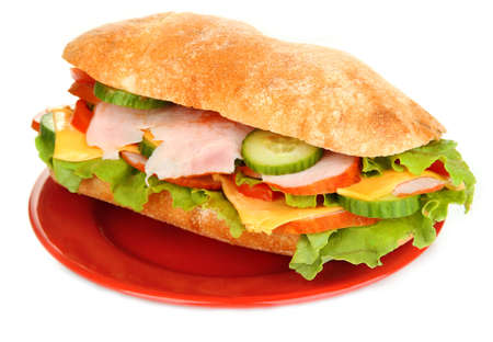 Fresh and tasty sandwich with ham and vegetables isolated on white Stock Photo - 18685691