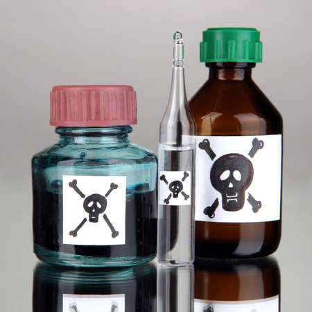 Deadly poison in bottles on grey background Stock Photo - 18686190