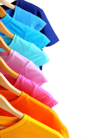 Lots of T-shirts on hangers isolated on white Stock Photo - 18766022